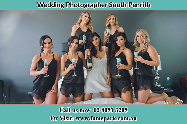 Photo of the Bride and the bridesmaids wearing lingerie and holding glass of wine South Penrith NSW 2750