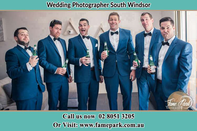 The groom and his groomsmen striking a wacky pose in front of the camera South Windsor NSW 2756