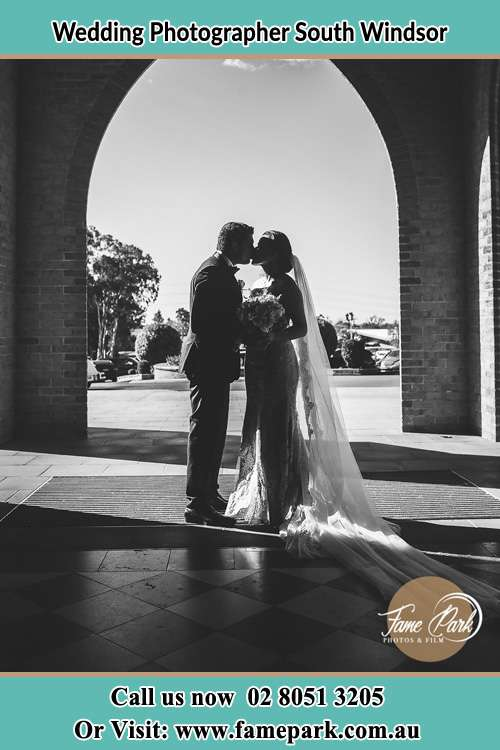 Photo of the Bride and the Groom kissing at the front of the church South Windsor NSW 2756