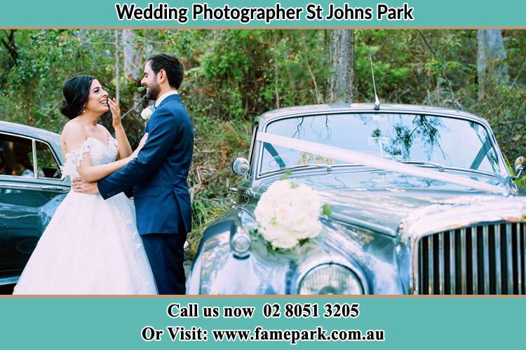 Photo of the Bride and the Groom near the bridal car St Johns Park NSW 2176