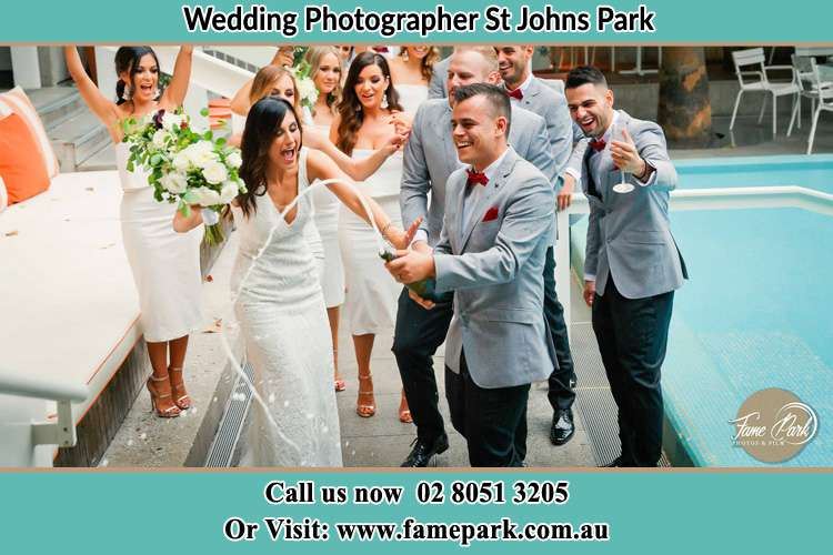 Photo of the Groom and the Bride celebrating with the secondary sponsors St Johns Park NSW 2176