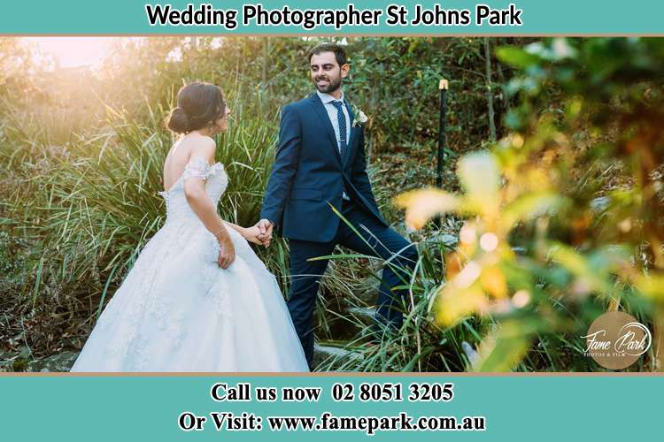 Photo of the Bride and the Groom going up the hill St Johns Park NSW 2176