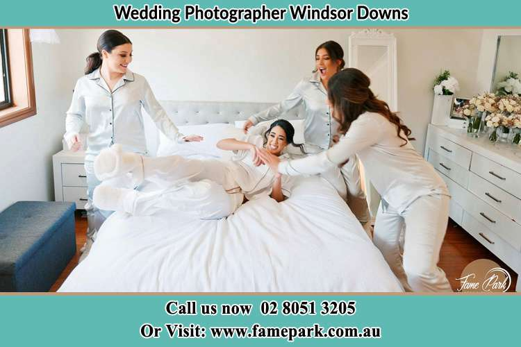 Photo of the Bride and the bridesmaids playing on bed Windsor Downs NSW 2756