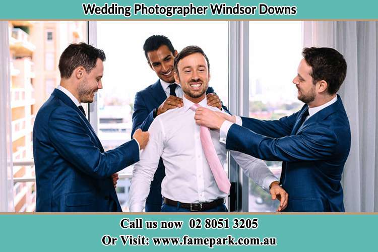 Photo of the Groom helping by the groomsmen getting ready Windsor Downs NSW 2756