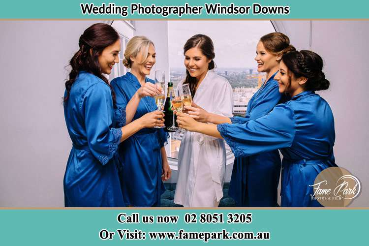 Photo of the Bride and the bridesmaids having wine Windsor Downs NSW 2756