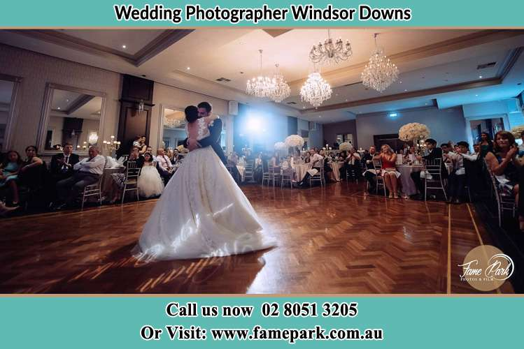 Photo of the Bride and the Groom hugging on the dance floor Windsor Downs NSW 2756