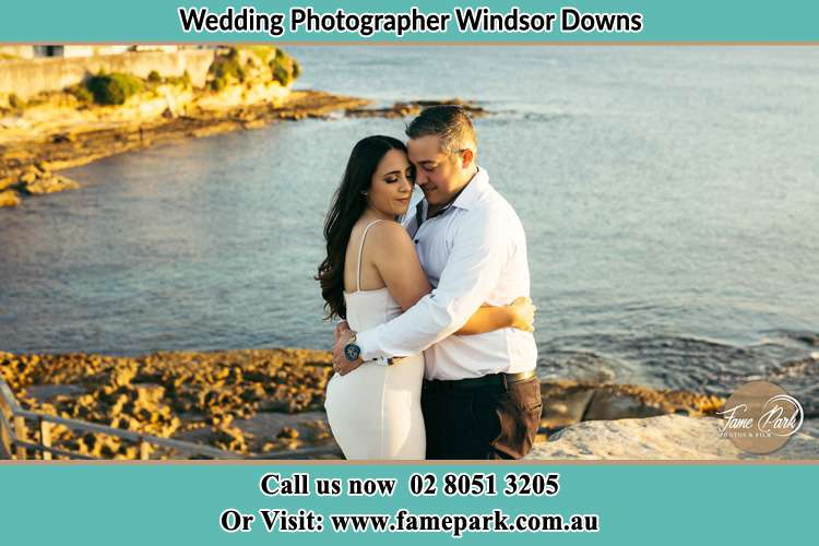 Photo of the Bride and the Groom hugging near the lake Windsor Downs NSW 2756