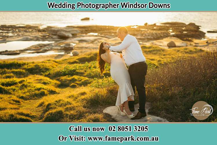 Photo of the Bride and the Groom dancing near the lake Windsor Downs NSW 2756
