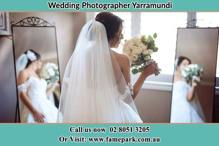 Photo of the Bride holding flower at the front of the mirrors Yarramundi NSW 2753